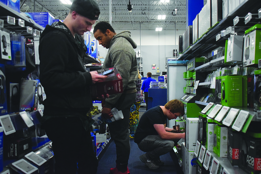 IOANNIS PASHAKIS/Sun-Gazette Customers shop for video game consoles and accessories on Thanksgiving night at the Best Buy near the Lycoming Mall.