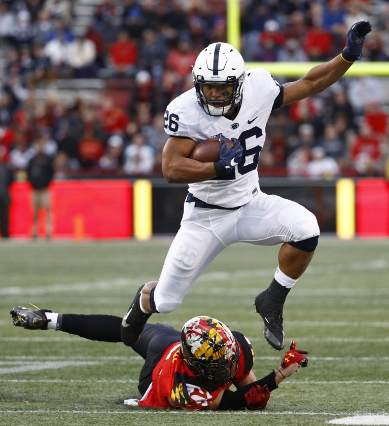 ASSOCIATED PRESS Penn State running back Saquon Barkley, top, rushes past Maryland linebacker Shane Cockerille in the first half Saturday at Maryland.