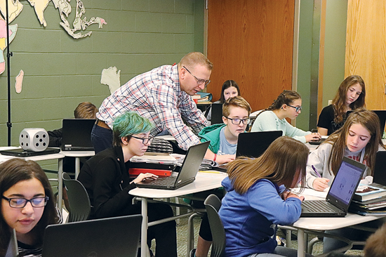 PHOTO PROVIDED Williamsport Area Middle School students work in a program to digitally design Mesopotamia signature seals, which ultimately will be printed on 3D printers.