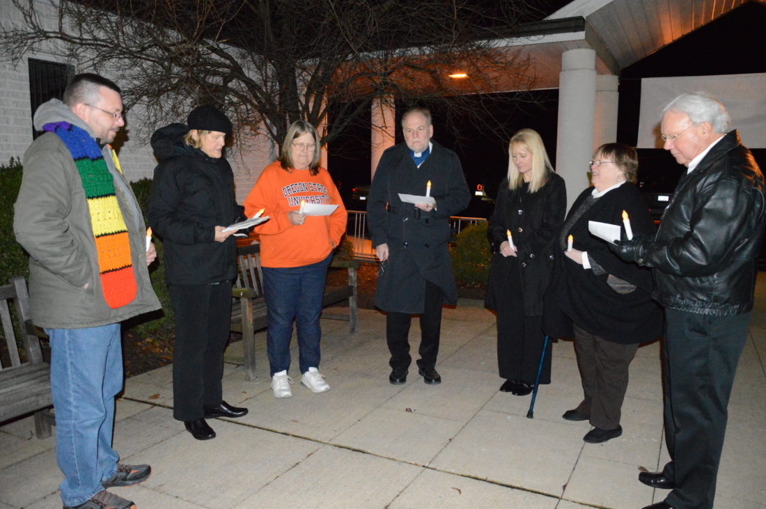 KATELYN HIBBARD/Sun-Gazette Several community members, many of them clergy members, gather to pray for love, healing and understanding during a candlelight vigil held Friday at St. Luke Lutheran Church in remembrance of those who battled HIV or AIDS as well as to raise awareness about the battles those living with HIV or AIDS still face.