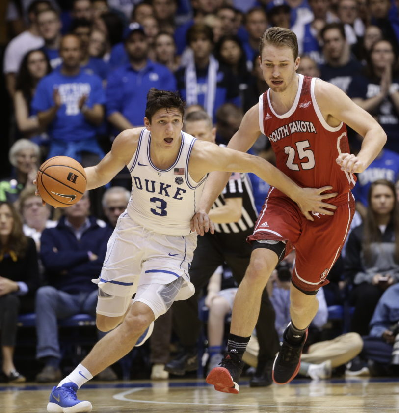 Duke's Grayson Allen (3) controls the ball against South Dakota's Tyler Hagedorn (25) during the first half of an NCAA college basketball game in Durham, N.C., Saturday, Dec. 2, 2017. (AP Photo/Gerry Broome)