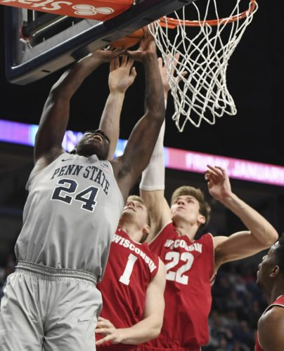 ASSOCIATED PRESS Penn State forward Mike Watkins, left, dunks against Wisconsin Monday at Penn State.