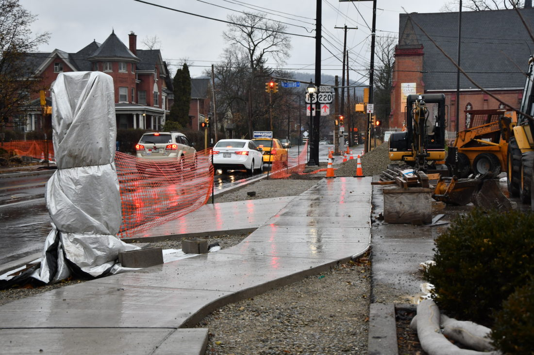 MARK NANCE/Sun-Gazette New sidewalks are under construction at the corner of Maynard and West Third streets Tuesday afternoon.