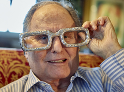 """In this Friday, Dec. 1, 2017, photo shows Budd Friedman, godfather of comedy at his home in Westwood district of Los Angeles. Friedman opened a dingy brick-walled nightclub called The Improvisation on the edge of New York's theatre district in 1963 there were no other comedy clubs to speak of in the country. Comics were generally relegated to playing small coffeehouses, telling mother-in-law jokes at summer resorts or keeping audiences entertained between strip shows. There are comedy clubs across the country now, and in Friedman's just-published memoir, """"The Improv: An Oral History of the Comedy Club That Revolutionized Stand-Up,"""" generations of comedians from Jay Leno to Jimmy Fallon give the author the lion's share of the credit. (AP Photo/Damian Dovarganes)"""