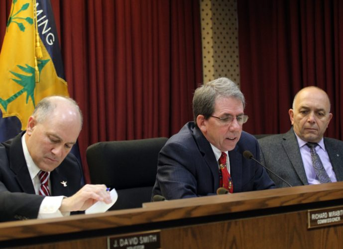 KAREN VIBERT-KENNEDY/Sun-Gazette From left, Lycoming County Commissioners Rick Mirabito, Jack McKernan and Tony Mussare adopted the resolution for the 2018 budget at their meeting Thursday in the city.
