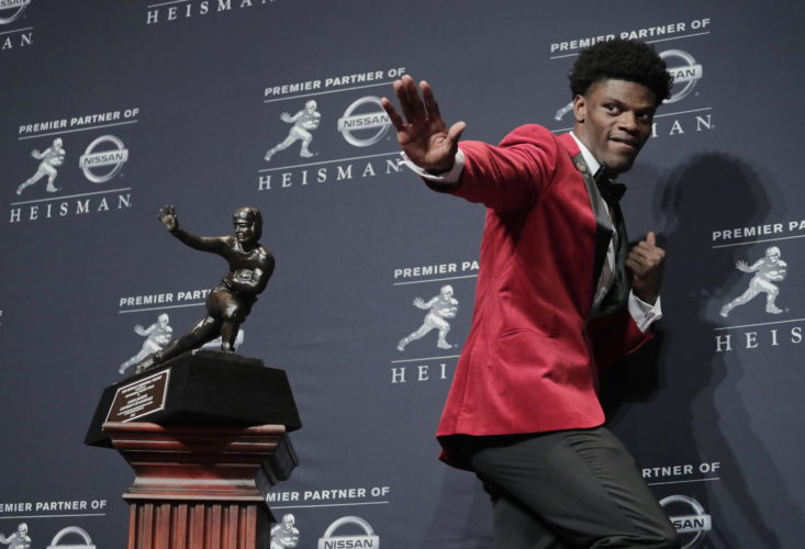 FILE - In this Saturday, Dec. 10, 2016, file photo, Louisville's Lamar Jackson poses with the Heisman Trophy after winning the award, in New York.  If anything, Heisman Trophy winner Lamar Jackson has been better this season than last. He has passed for 3,489 yards, ran for 1,443 yards and accounted for 42 touchdowns — another jaw-dropping performance for a Louisville team that was good, but not great. He believed he did enough to be a Heisman finalist and he got his wish. (AP Photo/Julie Jacobson, File)