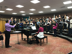 PHOTO PROVIDED Choir students rehearse with Maestro Edelstein at the high school.