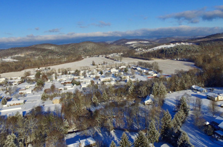 KAREN VIBERT-KENNEDY/Sun-Gazette A snow-covered town of Hughesville and Wolf Township is seen from a drone high above the photographer's home in Wolf Township on Thursday morning.