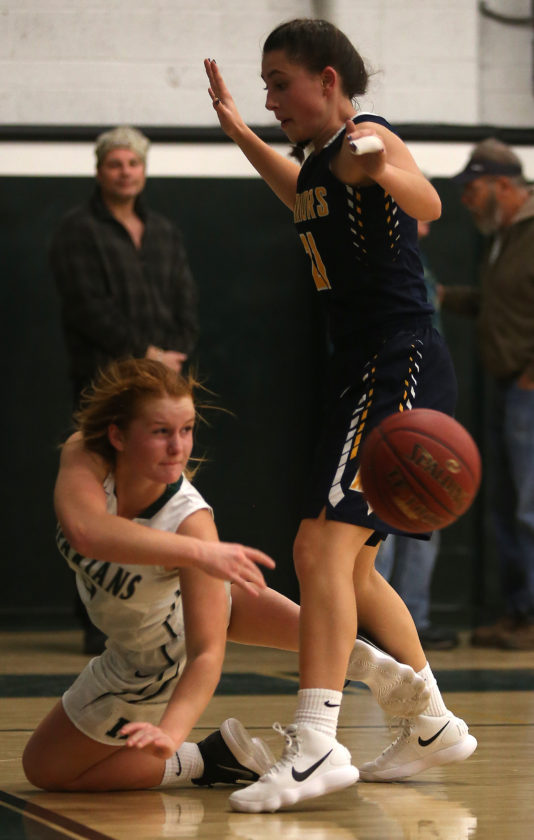 DAVE KENNEDY/Sun-Gazette Correspondent Jade Cordrey of Hughesville passes the ball around the defense of Rebecca Reeder of Montoursville Thursday at Hughesville.