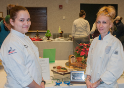 PHOTO PROVIDED The Best of Show recipient in Penn College's Fall Food Show was prepared by students Kelsie F. Thomas, left, of Darby, and Ashley R. Potrzebowski, of Williamsport, as part of their Advanced Garde Manger course. They were tasked with creating a cold platter and charcuterie board.
