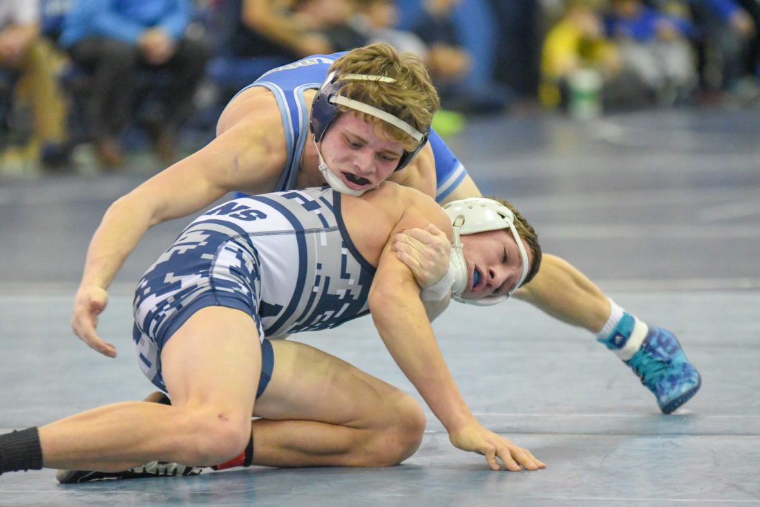 TIM WEIGHT/For The Sun-Gazette Seth Andrus of Central Mountain, top, wrestles Christian Good of Muncy Friday at the King of the Mountain at Central Mountain.