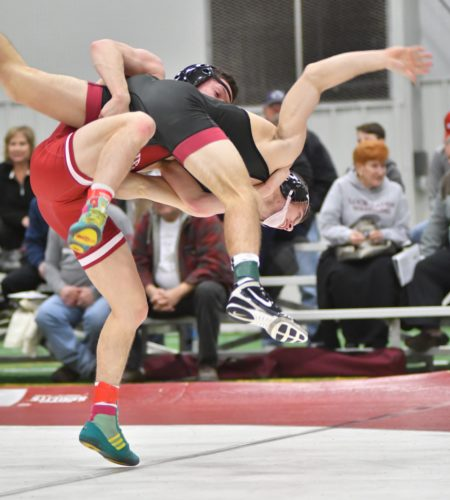 MARK NANCE/Sun-Gazette Lock Haven's Luke Werner takes down Bloomsburg's Drew Massetti in his 14-4 major decision at 125 pounds Saturday at Liberty Arena.