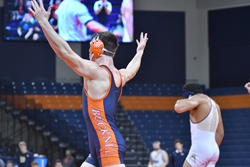 MARK NANCE/Sun-Gazette Bucknell's Garrett Hoffman raises his arms after defeating Pitt's Kellan Stout to secure the Bison's win over the Panthers on Sunday afternoon Sojka Pavilion.