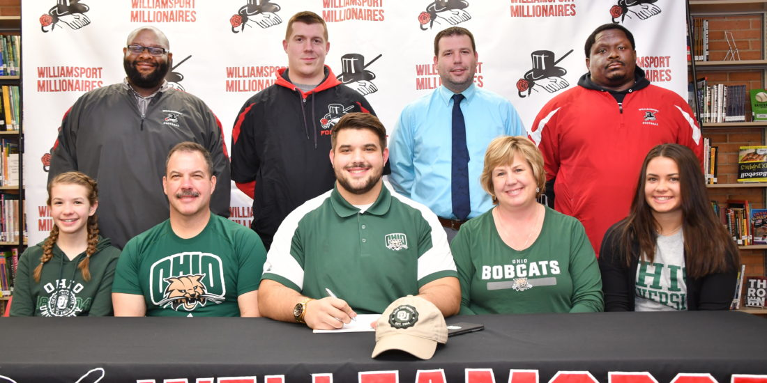 MARK NANCE/Sun-Gazette Williamsport's Kurt Danneker signed a letter-of-intent to play football at Ohio University Wednesday. From front left is Brooke Danneker, sister, Dave, is father, Kurt, Sue,, mother, and Nicole, sister. Back left is WAHS Football Head Coach Chuck Crews, Coaches Keith McCabe, Pat Ross, and Kevin Brown.