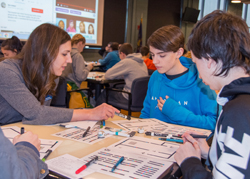 """PHOTO PROVIDED Alicia McNett, instructor of computer information technology at Penn College, guides a high school student in programming an Ozobot. The workshop was part of an """"Hour of Code"""" event hosted by Penn College and attended by several high schools. It is part of an international initiative to encourage interest and confidence in the skills needed to join the computer science workforce."""