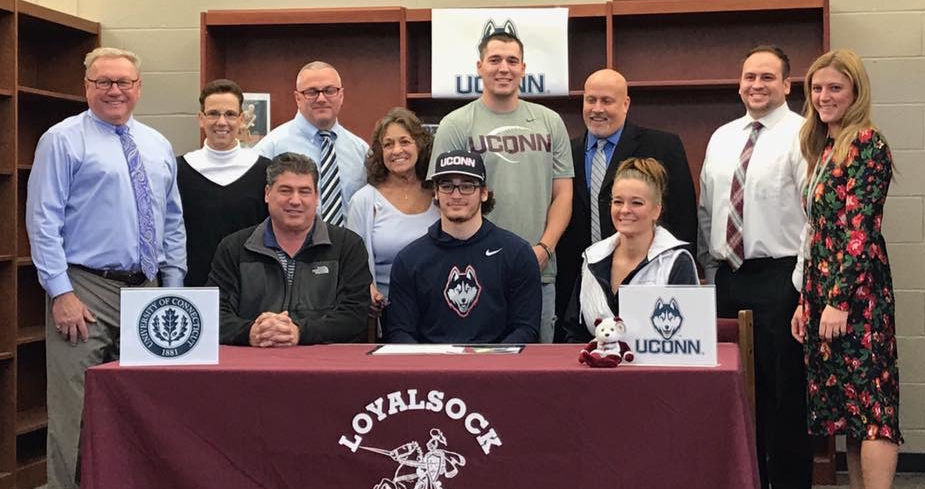PHOTOPROVIDED Loyalsock'sHunter Webb (center) signed his letter of intent to play football next year at Connecticut. Sitting on either side of Hunter are his parents, Jim and Michelle. Standing in the back are, from left, Loyalsock athletic director Ron Insinger, trainer Marilouise Mazzante, principal Matthew Reitz, grandmother Theresa Kaiser, brother Jimmy Webb, trainer Mark Stiller, football coachJustinVan Fleet and assistant principal Ashley Sekel.