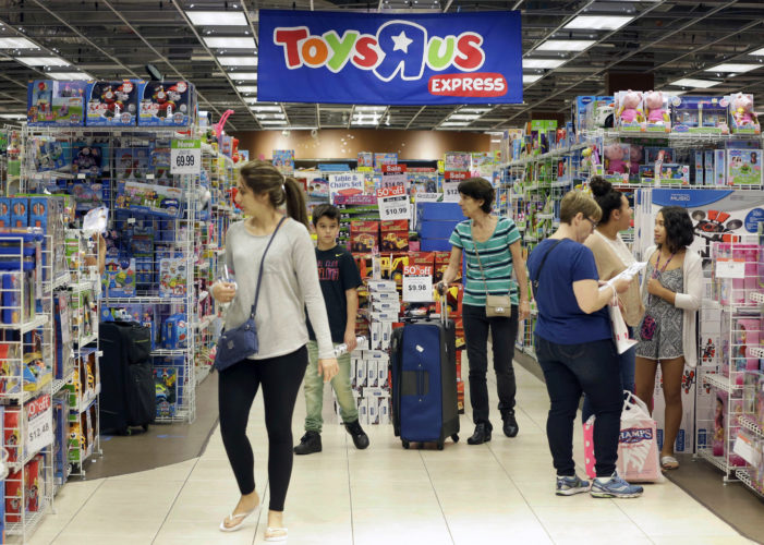 ASSOCIATED PRESS Shoppers browse at a Toys R Us store in Miami.