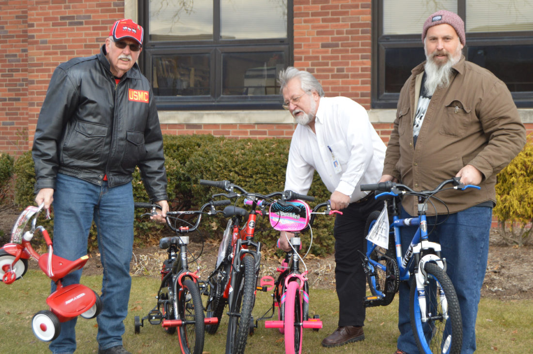 PAT CROSSLEY/Sun-Gazette Correspondent From left: Bill Mericle, of Toys for Tots, and state Department of Transportation workers Malcolm Derks and Al Uscowskas prepare to load the 46 bicycles that employees of the department's District 3 office purchased to donate. Derks is responsible for purchasing the bikes, while Uscowskas coordinates the district's Bill Craver Bikes for Tykes program.