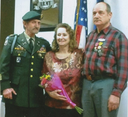 PHOTO PROVIDED U.S. Army Sgt. Howard Steppe, right, finally receives his service medals earned in the Vietnam War, during a recent ceremony at the Jersey Shore Veterans of Foreign Wars from retired U.S. Army Maj. Galen Klobe, left. Steppe's wife, Betty, stands between the veterans.