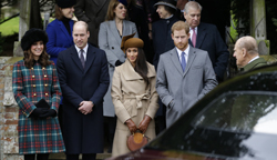 Kate, Duchess of Cambridge, left, with Prince William, Meghan Markle and Prince Harry wait as the Queen leaves by car following the traditional Christmas Day church service, at St. Mary Magdalene Church in Sandringham, England, Monday, Dec. 25, 2017. (AP Photo/Alastair Grant)