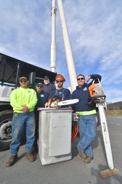 MARK NANCE/Sun-Gazette During last year's snow storm in March and high winds in May, members of the city's department of streets and parks went out of their way in their service to the city. From left is Galen Beach, parks, Tom Gotshall, equipment operator, Dave Johns, utility manager, Chad Echert, city forester, and Shawn Bastian, truck driver.