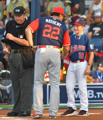 MARK NANCE/Sun-Gazette St. Louis Cardinals manager Mike Matheny (22) congratulates Jackson, N.J'.s, Garrett Drew after Drew brought him the lineup card before the MLB Little League Classic Aug. 20 at Bowman Field.