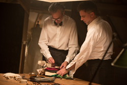 """In this image released by Focus Features, Daniel Day-Lewis, left, appears with director Paul Thomas Anderson on the set of """"Phantom Thread.""""  In ÔPhantom Thread,Õ  Anderson stitches together a ÔpeculiarÕ love story for what Daniel Day-Lewis has said will be his final film. (Laurie Sparham/Focus Features via AP)"""