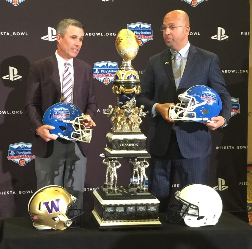 CORY GIGER/For The Sun-Gazette Chris Petersen and James Franklin pose Friday with the Fiesta Bowl trophy.