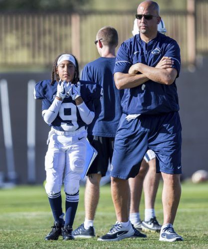 ASSOCIATED PRESS Penn State coach James Franklin and his daughter Shola, left, watch during Fiesta Bowl practice this past week in Scottsdale, Ariz.
