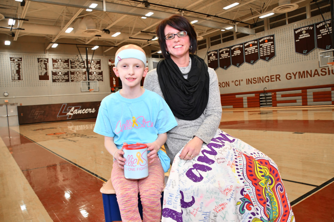 MARK NANCE/Sun-Gazette Callie Cavanaugh, left, of Loyalsock Township and Jenn Gray of Williamsport were chosen to share this year's Sun-Gazette Person of the Year honors for selfless acts each demonstrated in the past year. Cavanaugh, who has been battling Rhabdomyosarcoma, a childhood cancer, has spent her time raising money to help others afflicted with childhood cancer. Gray donated a kidney to a co-worker at Williamsport Area Middle School.
