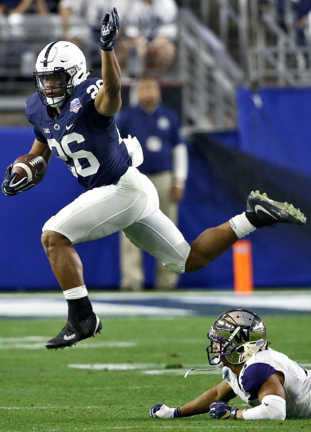 ASSOCIATED PRESS Penn State running back Saquon Barkley (26) leaps over Washington defensive back Myles Bryant (5) during the second half of the Fiesta Bowl Saturday in Glendale, Ariz.