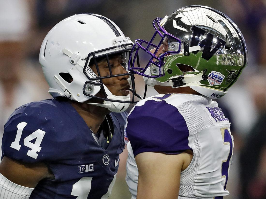 Washington quarterback Jake Browning (3) and Penn State cornerback Zech McPhearson (14) exchange words during the first half of the Fiesta Bowl NCAA college football game Saturday, Dec. 30, 2017, in Glendale, Ariz. (AP Photo/Rick Scuteri)