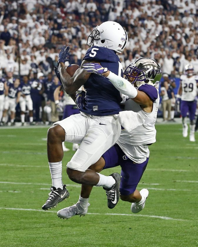 ASSOCIATED PRESS Penn State wide receiver DaeSean Hamilton (5) pulls in a touchdown catch as Washington defensive back Myles Bryant defends during the second half Saturday in Glendale, Ariz.