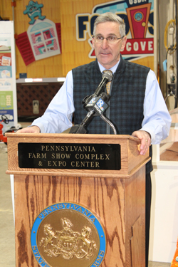 CARA MORNINGSTAR/Sun-Gazette Russell Redding, Pennsylvania secretary of agriculture, talks about state accomplishments during the duck slide and chick hatch opening event at the Pennsylvania Farm Show in Harrisburg on Thursday.