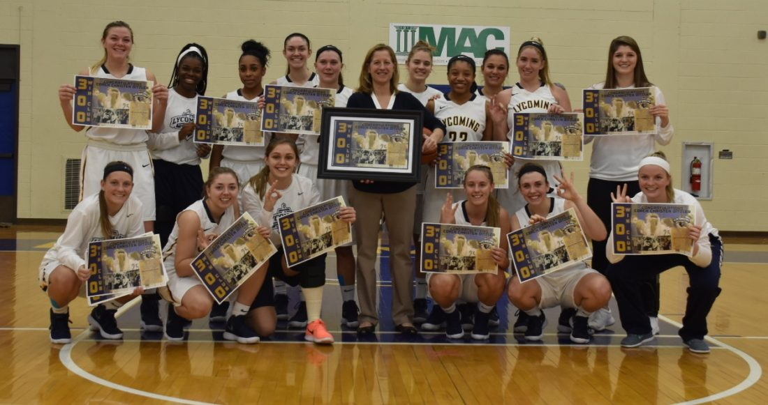 LYCOMING ATHLETICS Lycoming players surround coach Christen Ditzler after her 300th career victory Monday night at Lamade Gym.