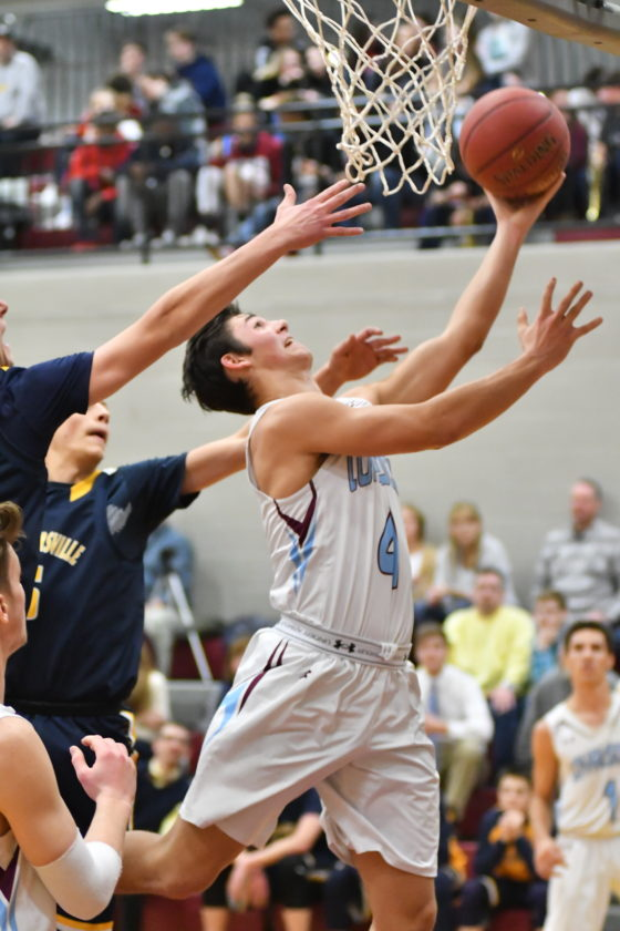 MARK NANCE/Sun-Gazette Loyalsock's Connor Watkins (4) splits the Montoursville defense to shoot during the second quarter at Loyalsock on Tuesday evening.