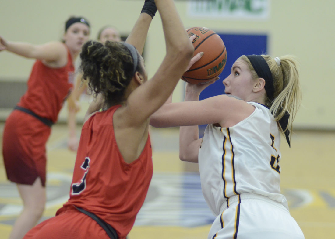 RALPH WILSON/Sun-Gazette Correspondent Lycoming's Shelby Mueller (5) looks to the basket around an Albright's MiKayla Lea (3) Wednesday at Lamade Gym.