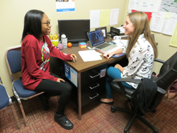 CARA MORNINGSTAR/Sun-Gazette Genesis Clark, eleventh grade student, left, speaks with Kaitlin Eck, the new Williamsport Area High School career counselor, at a recent visit to Eck's office in the guidance department at Williamsport Area High School.