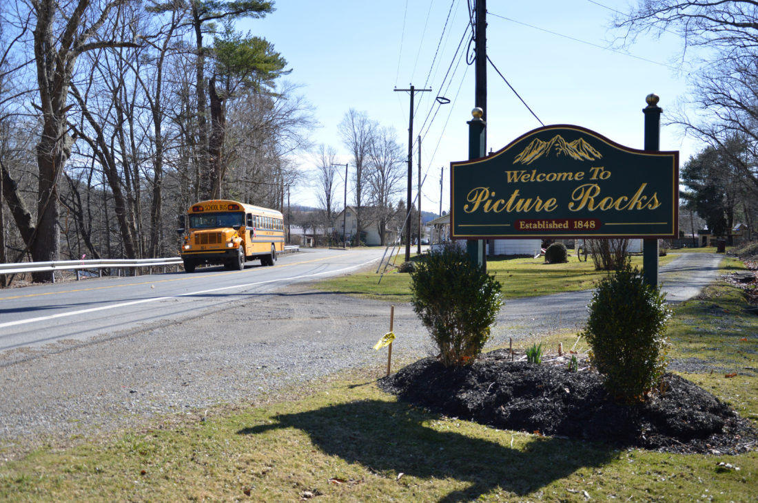 "KATELYN HIBBARD/Sun-Gazette The ""Welcome to Picture Rocks"" sign at the entrance to the borough from Route 220 southbound is one of two erected by an Eagle Scout in 2006. Now, more than a decade later, the state wants the signs to be removed."