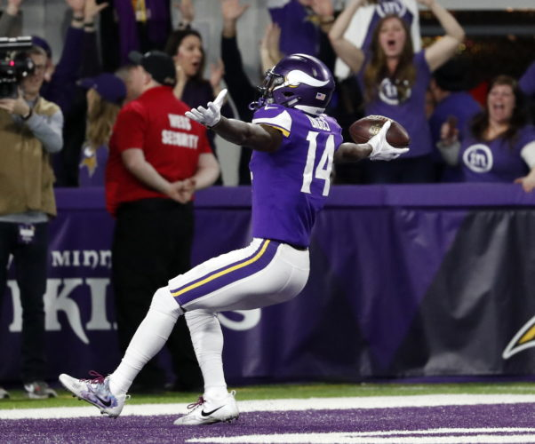 Minnesota Vikings wide receiver Stefon Riggs runs in for a game winning touchdown against the New Orleans Saints during an NFC Divisional Playoff game in Minneapolis on Sunday. (AP)