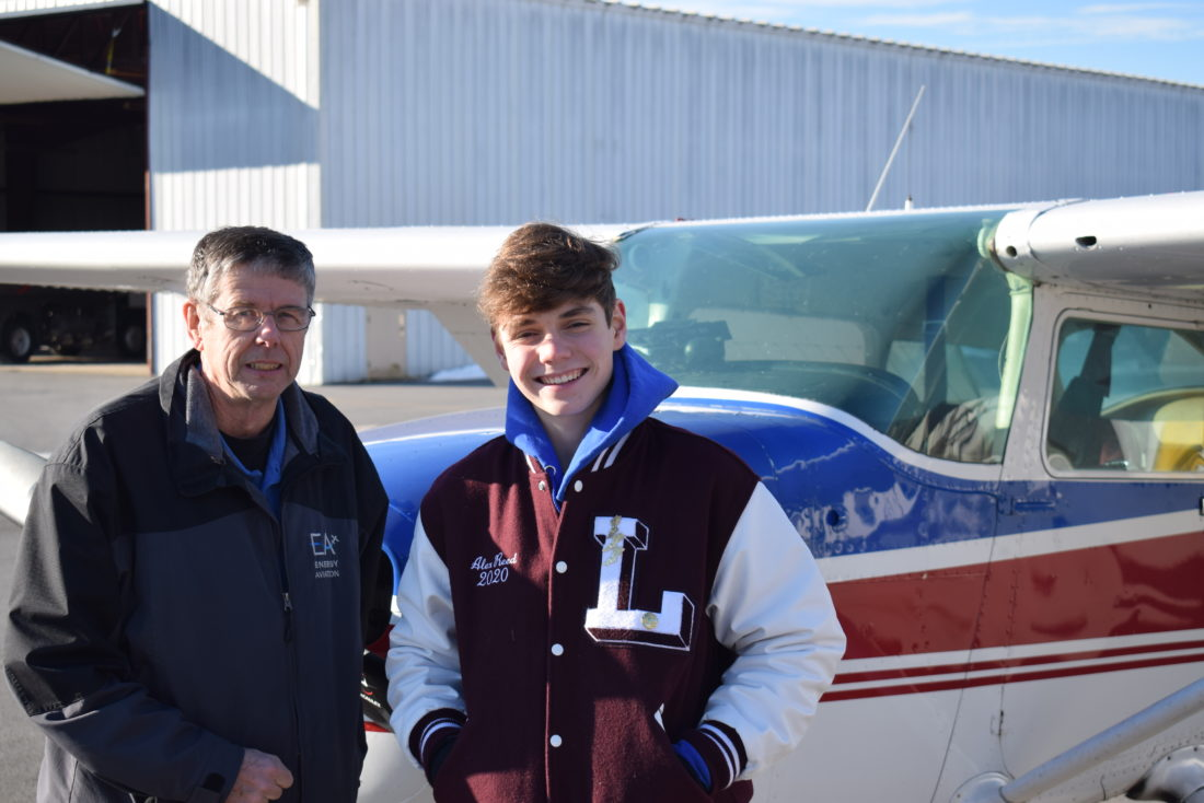 Colonel Dave Hall stands with Alex Reed, his youngest student to fly solo among thousands he has taught.