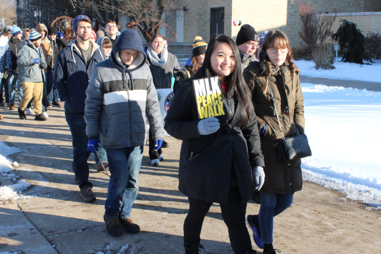 CARA MORNINGSTAR/Sun-Gazette Volunteers brave the cold to walk around Pennsylvania College of Technology campus in order to promote peace and understanding in the community during the Rev. Martin Luther King Jr. Peace Walk and Day of Service at Penn College on Monday.