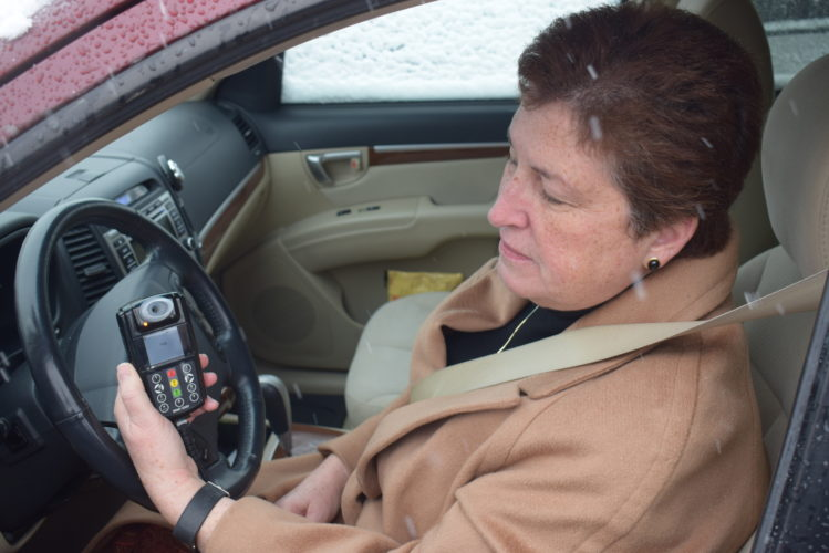 IOANNIS PASHAKIS/ Sun-Gazette Kathleen Riley, of Smart Start Inc., demonstrates how to use an ignition interlock device after it is installed into a vehicle.