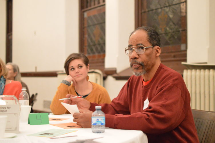 KATELYN HIBBARD/Sun-Gazette Richard James, a member of the Beloved Community Council, relays some of his group's ideas for breaking down divisive stereotypes both at a personal level and as a community.