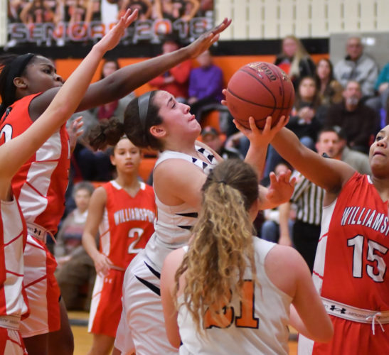 MARK NANCE/Sun-Gazette Jersey Shore's Hannah Kauffman tries to shoot in a crowd of Williamsport's Samiya Little, back, and Gabby Thomas, front in the fourth quarter Thursday at Jersey Shore.