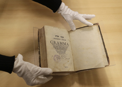 "The book titled ""Mikne Avram - Peculium Abrae"" is displayed at the Prague's Jewish Museum in Prague, Czech Republic, Tuesday, Jan. 16, 2018. A rare 16th century book that used to belong to Prague's Jewish community before World War II and was considered lost has been returned after it reappeared at an auction held by New York based auction house. (AP Photo/Petr David Josek)"