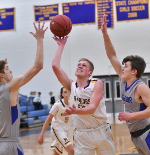 M,ARK NANCE/Sun-Gazette Montoursville's Luke Warnecke (33) shoots between Warrior Run's Gage Anzulavich, left, and Austin Soltesz (1) in the first quarter Friday at Montoursville.