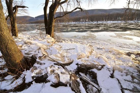 MARK NANCE/Sun-Gazette Ice on the bank and ice floes on the Susquehanna River, as seen from Riverfront Park, have officials concerned about potential flooding due to rain expected to start today and continue through much of the week.
