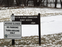 KAREN VIBERT-KENNEDY/Sun-Gazette Signs posted by the state Fish and Boat Commission warn visitors that the Muncy access area to the West Branch of the Susquehanna River is closed.