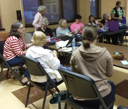 PHOTO PROVIDED Members of the the Warren County Fiber Artists learn how to do the seersucker stitch.